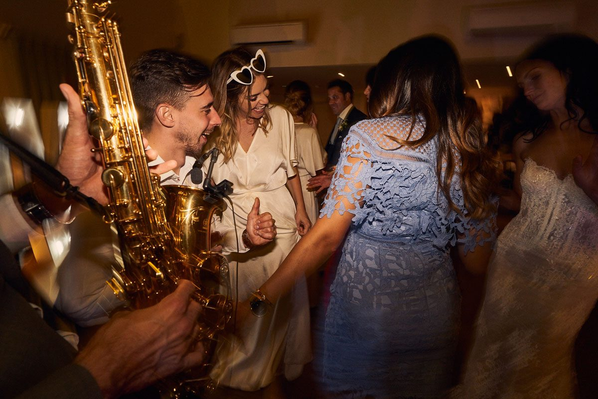 dan Goode playing sax on a packed dancefloor