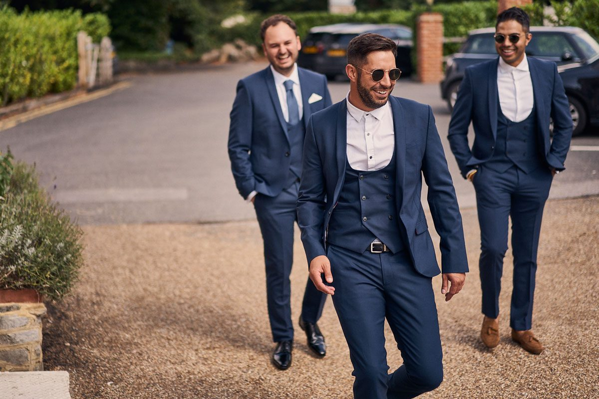 Best Men mucking about outside Millbridge Court