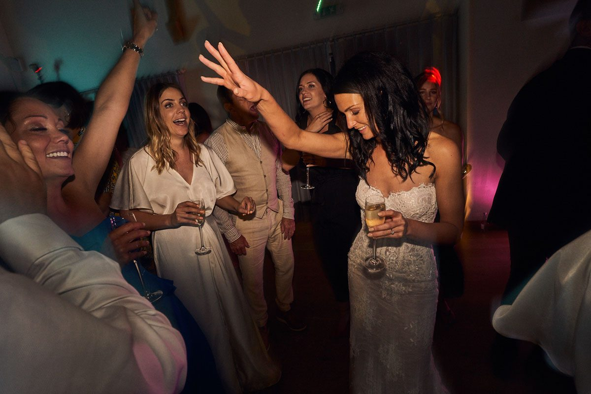 Bride dancing surrounded by her Bridesmaids