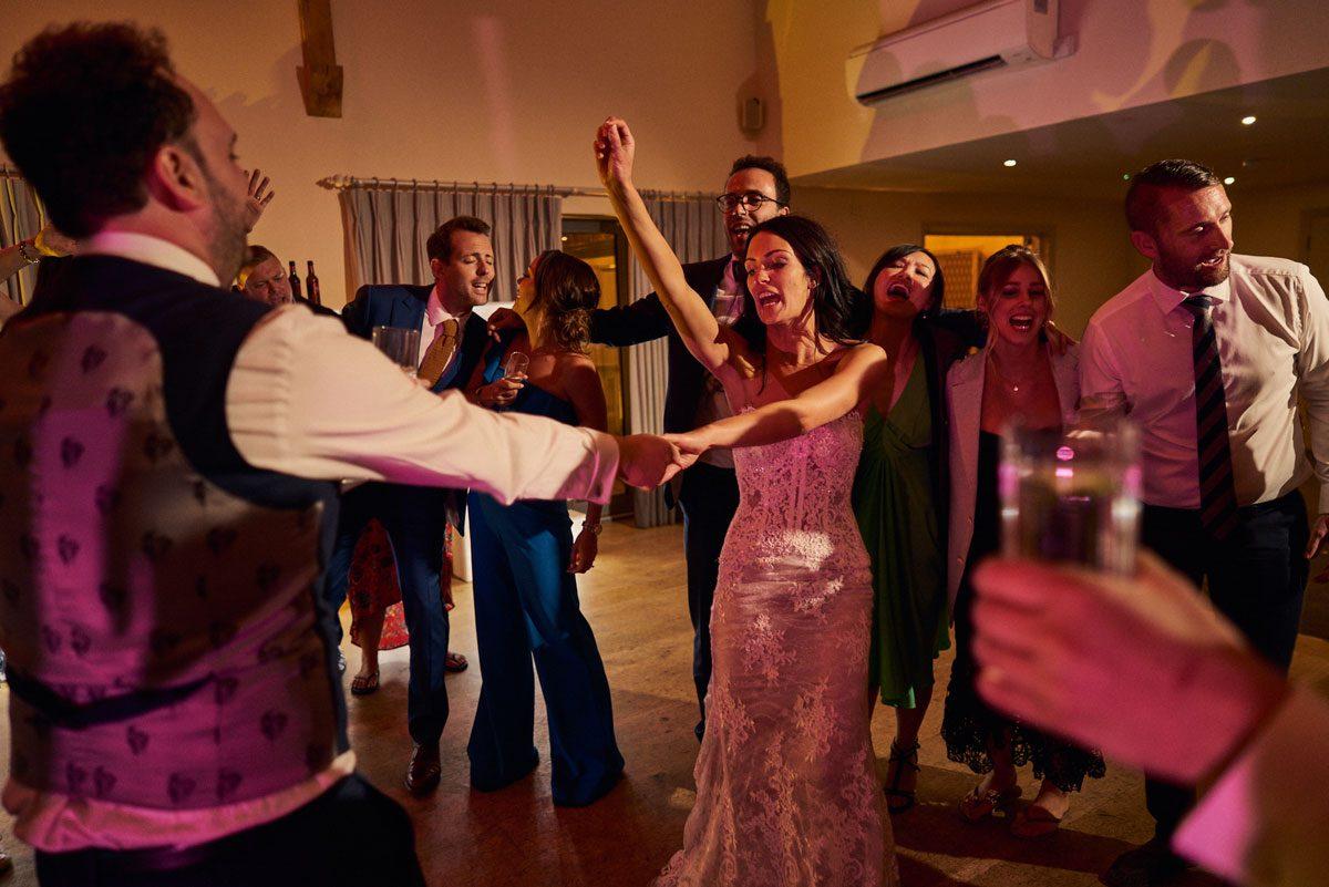 Groom spinning Bride around