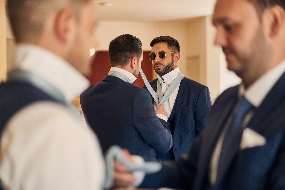 Best Men doing each other's tie's up