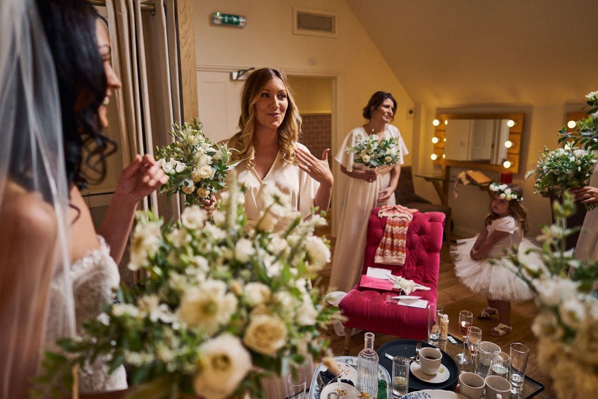 Bridesmaids almost in tears at Bride wedding dress