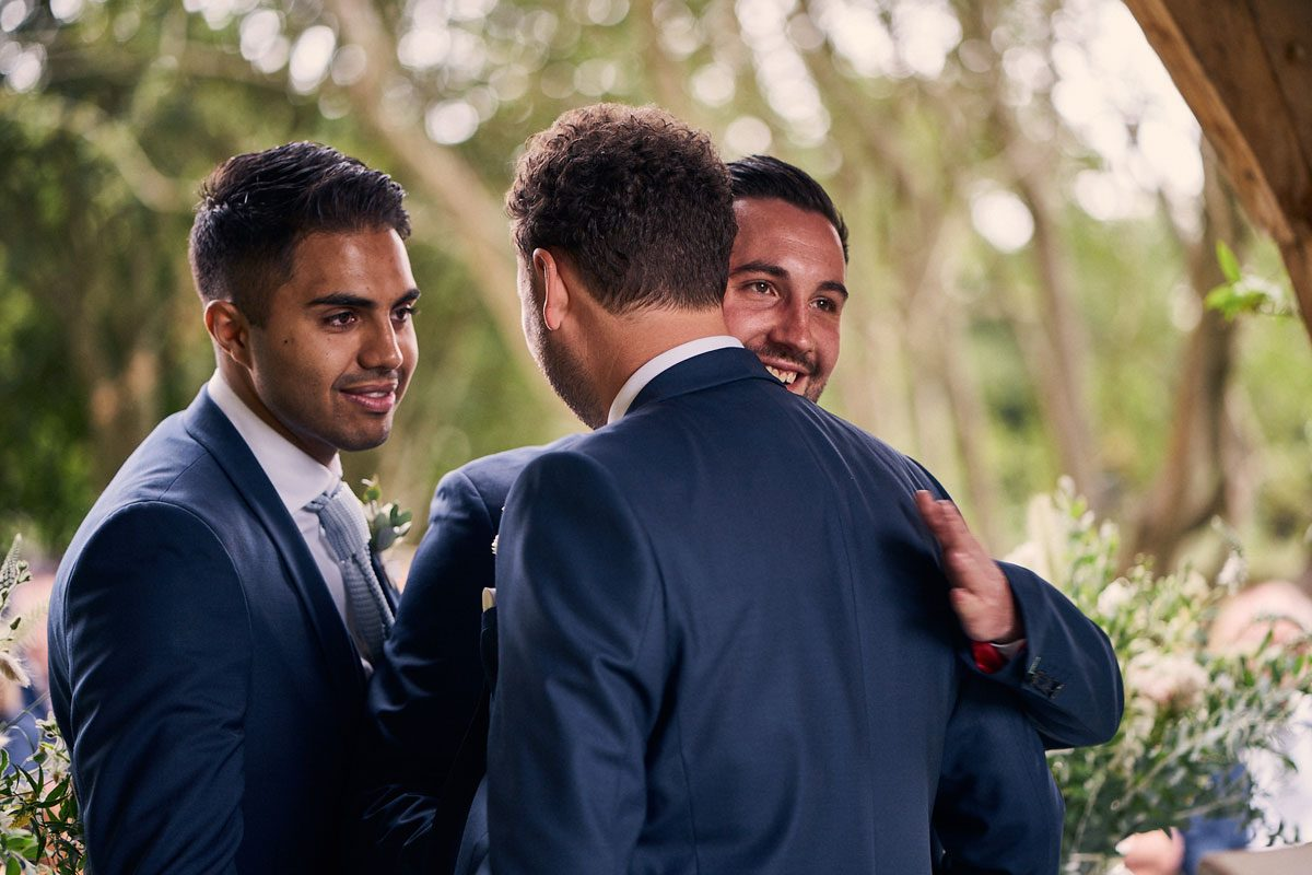 Best Men comforting emotional groom before wedding ceremony