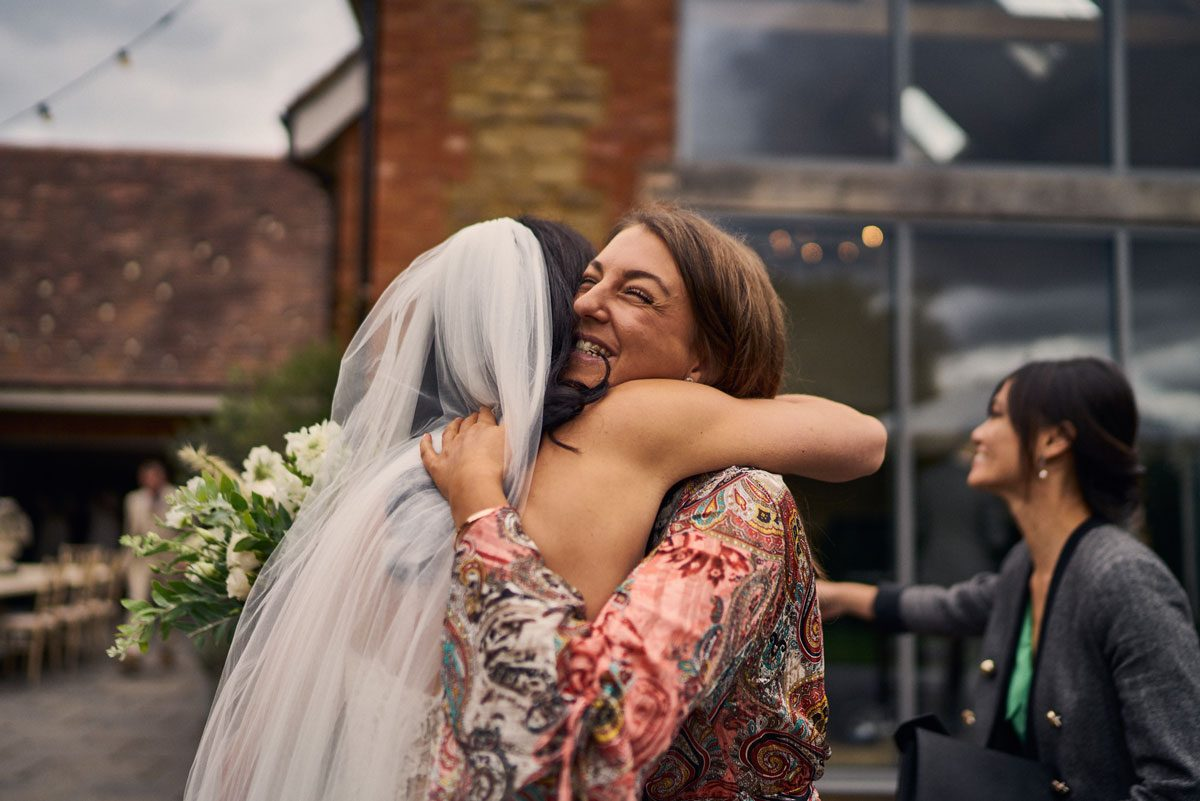 wedding guest giving bride a big hug