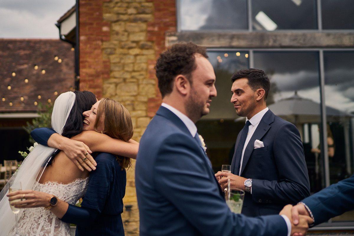 wedding guests congratulating Bride & Groom