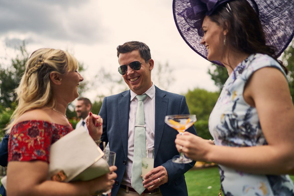 wedding guest enjoying cocktails outside