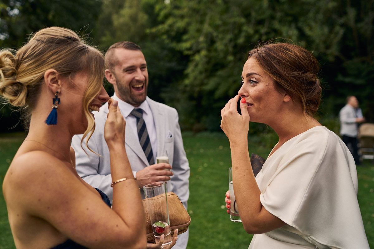 wedding guest laughing and joking with Bridesmaid