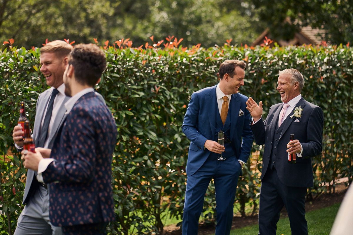 Father of the Bride laughing with wedding guest