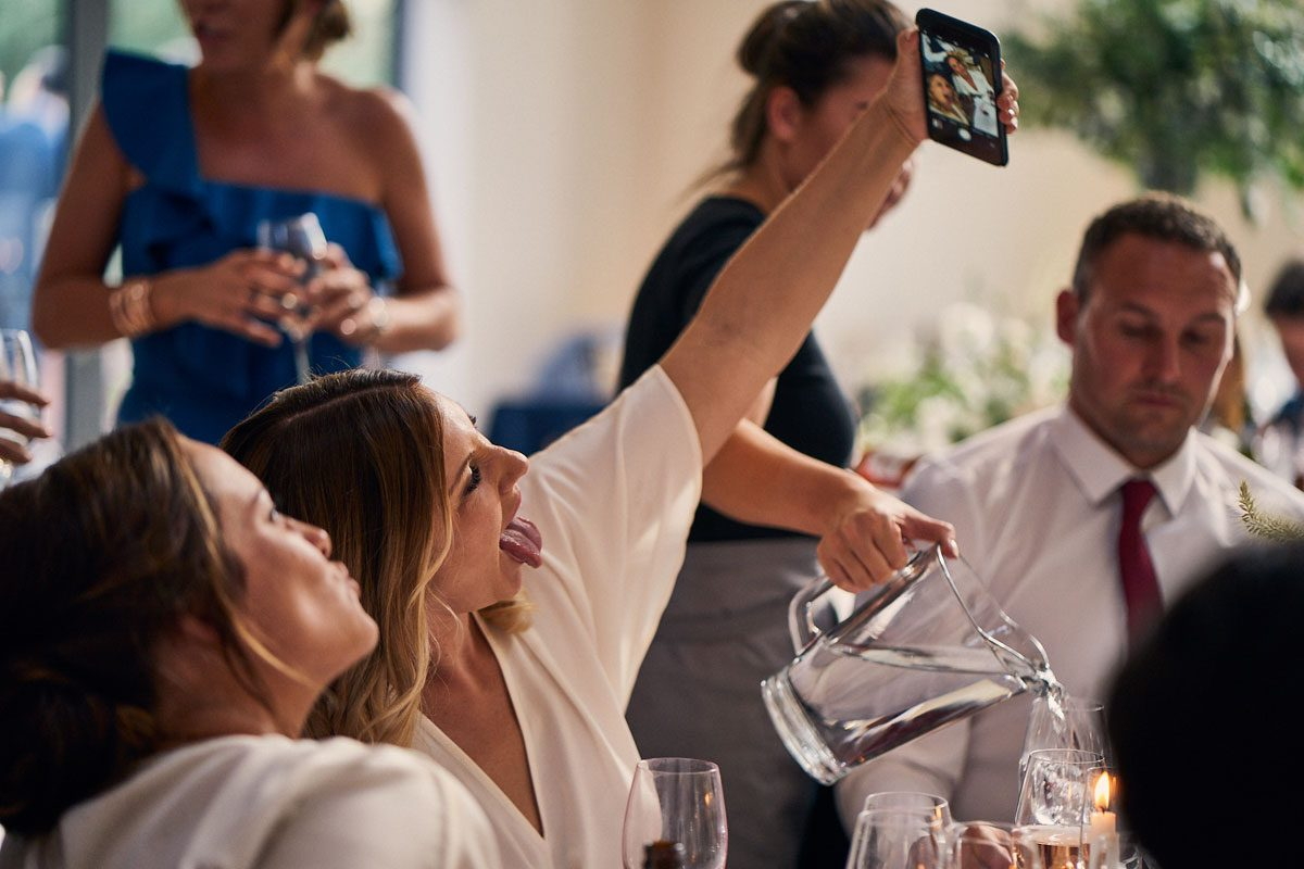 Bridesmaids taking a silly selfie