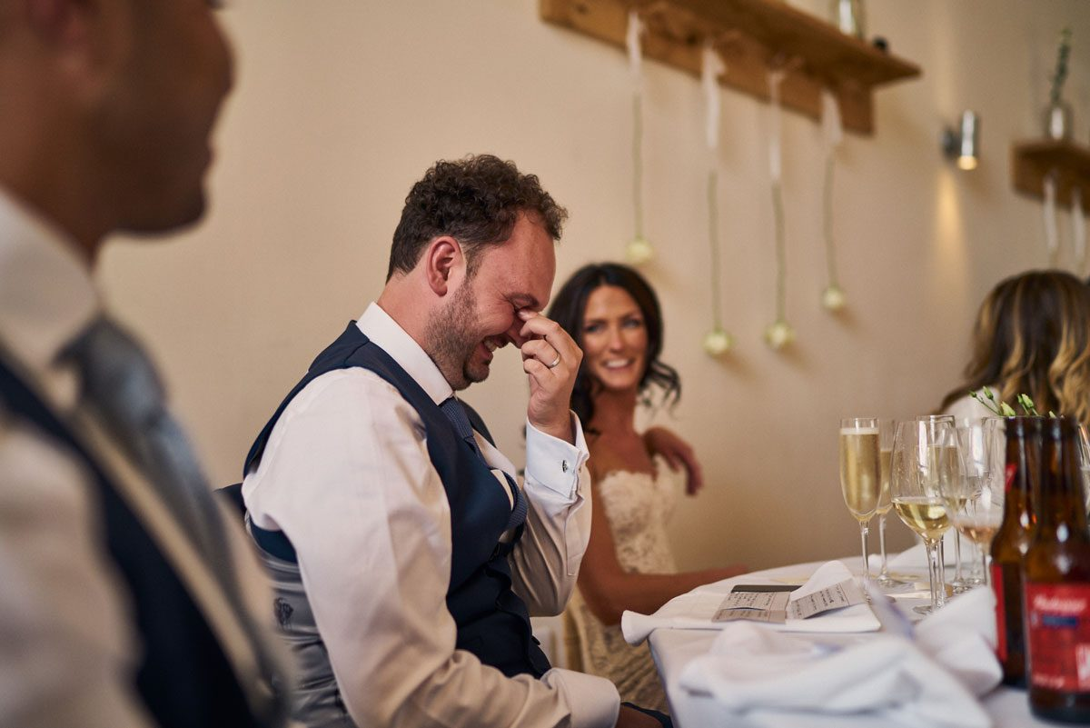 bride laughing at embarrassed Groom