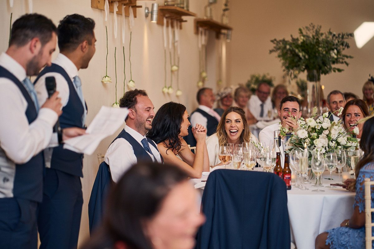 everyone laughing at the Best Man
