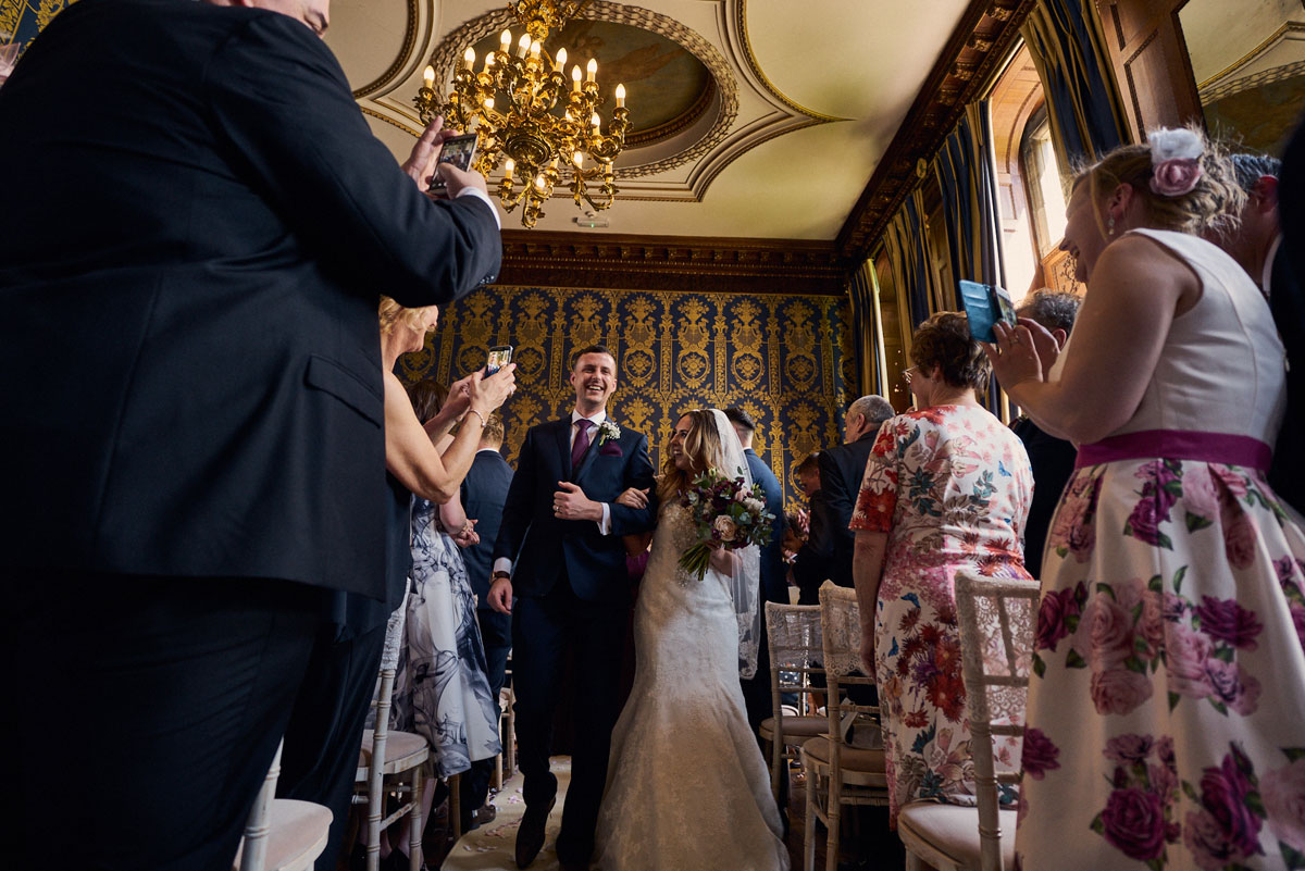 Bride & Groom leave Soughton Hall ceremony room arm in arm just married!