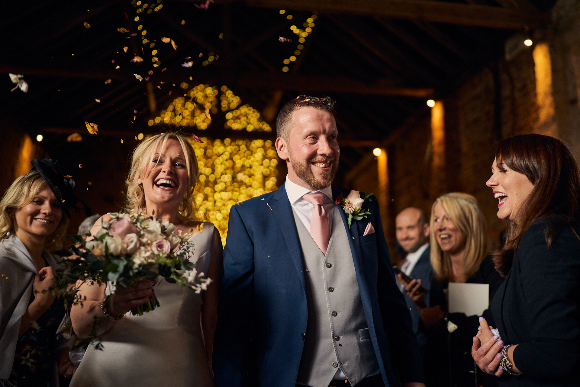 Bride & Groom leave the Ceremony Barn at The Normans in a shower of confetti