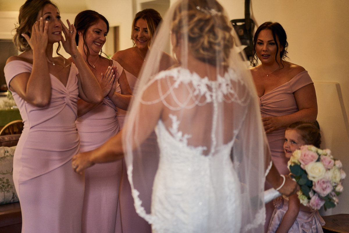 bridesmaids reaction to seeing bride in her dress for the first time
