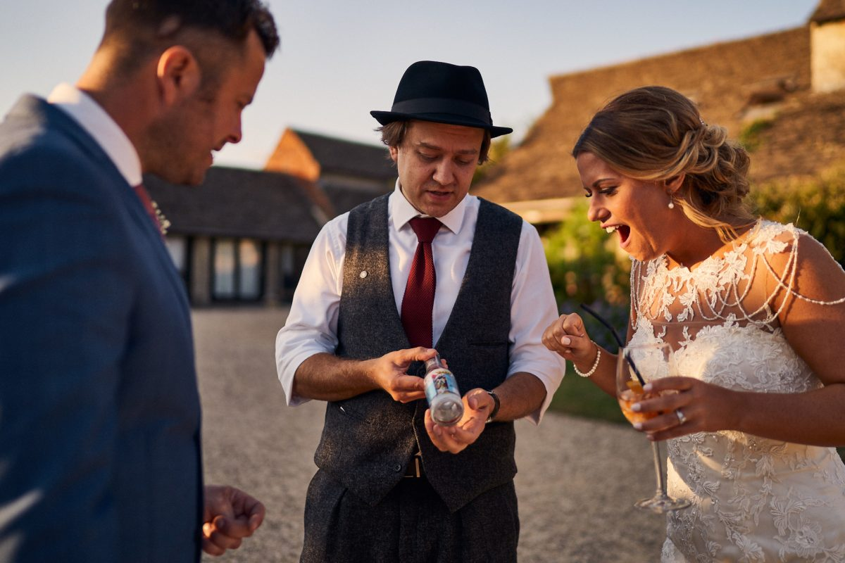 bride and groom wowed by magician at the great tythe barn