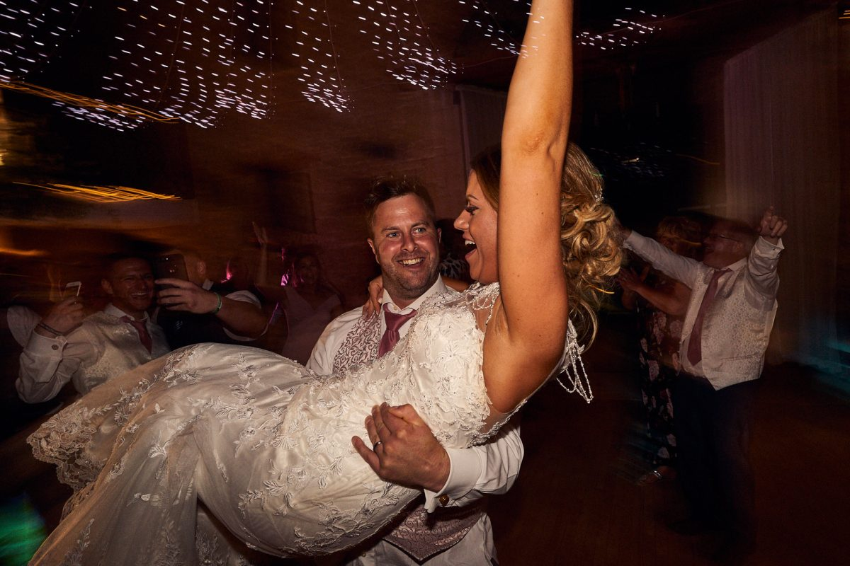 groom spinning bride around