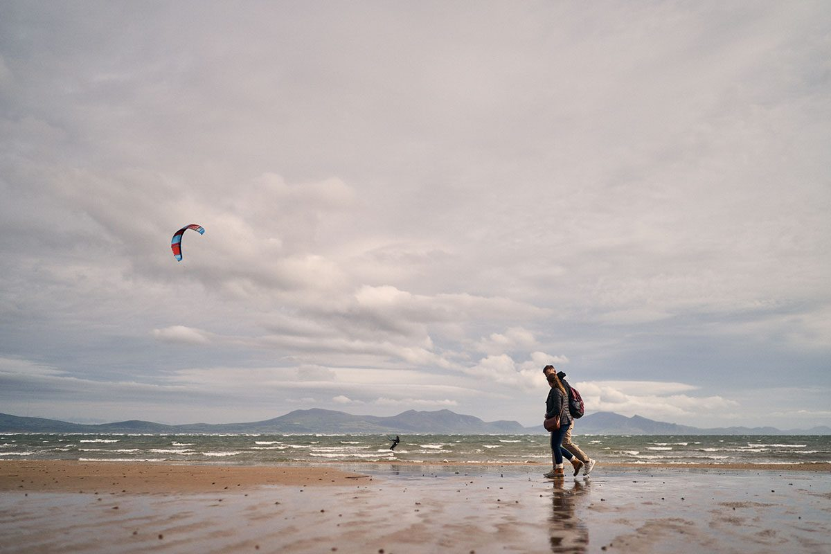 Documentary couple photo session on Newborough Beach