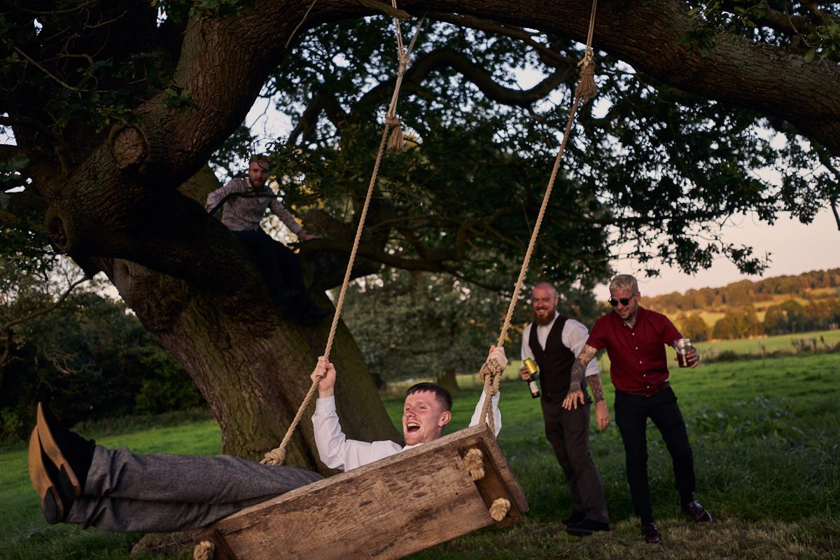 drunk wedding guests on the swing